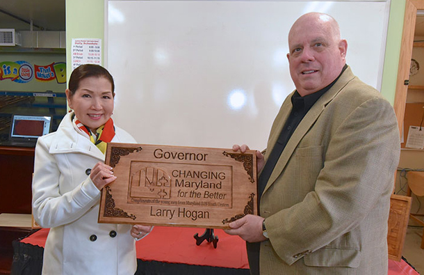 Governor Larry Hogan and First Lady Yumi Hogan Holding Changing Maryland for the Better Plaque